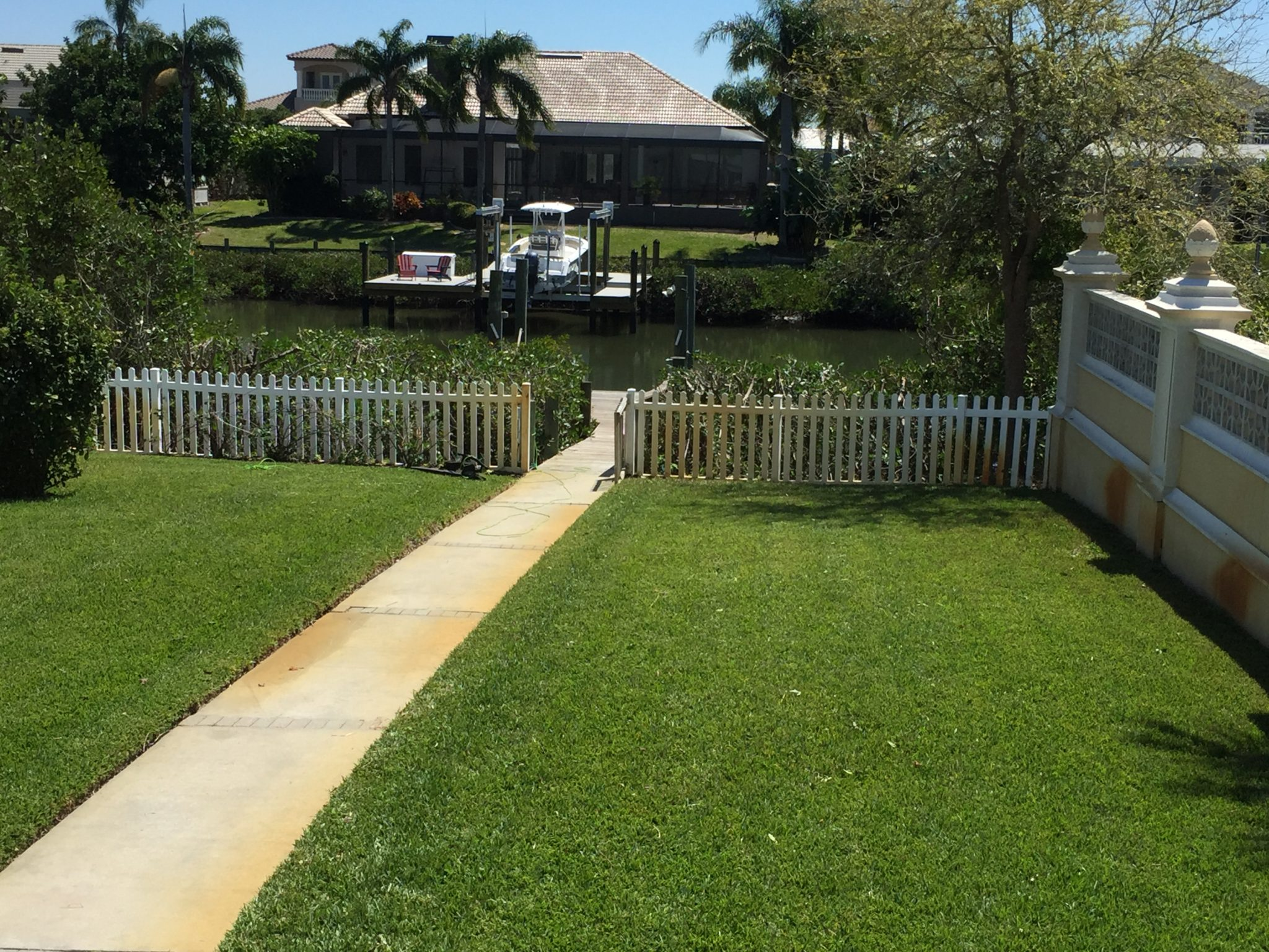 This owner was delighted with his new view of the water. We trimmed the mangroves from 14' to 7' tall.